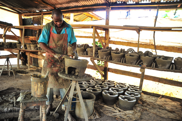 A Kenyan man produces improved cookstoves out of clay.